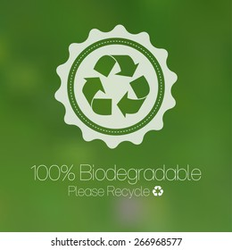Green recycle design against blurred background.