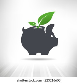 Green Savings. Piggy bank with green leaves growing out of it.