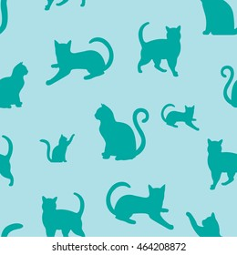 Green seamless background with cats silhouettes