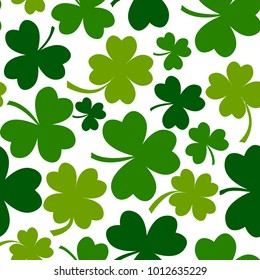 Green seamless pattern with four and tree leaf clovers for Saint Patrick's Day. Vector illustration