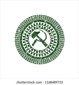 Green sickle and hammer icon inside distressed rubber stamp