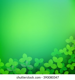 Green spring background with clover leaves. Springtime background with place for text.
