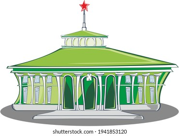 green station building with spire and red star