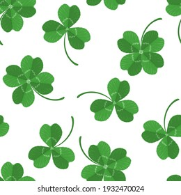Green three-leaves and four-leafed clover leaves seamless pattern. Vector illustration in cartoon flat style. Saint Patrick's Day background.