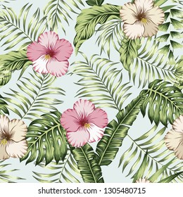 Green tropical banana palm leaves and pink, brown hibiscus seamless pattern on the white background. Realistic vector botanical composition