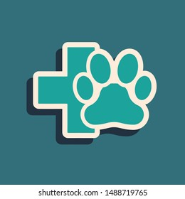 Green Veterinary clinic symbol icon isolated on blue background. Cross hospital sign. A stylized paw print dog or cat. Pet First Aid sign. Long shadow style. Vector Illustration