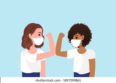 Greet elbow bump icon.Smiling diverse female colleagues wearing protective face masks greeting bumping elbows at workplace, woman coworkers in facial covers protect from COVID-19 coronavirus in office