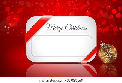 Greeting card for Christmas with  Christmas ball  on winter background with snow and snowflakes