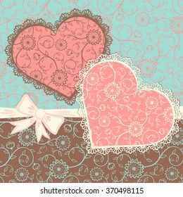 Greeting card with lacy heart shapes. Vintage style. Vector illustration.