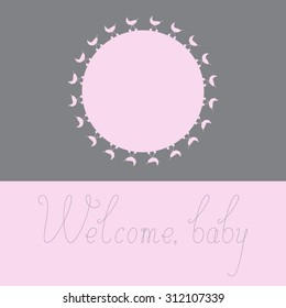 Greeting card with pink colored round space for photo decorated with pink colored prams on grey background, grey colored calligraphic lettering Welcome baby on pink background. Baby shower invitation