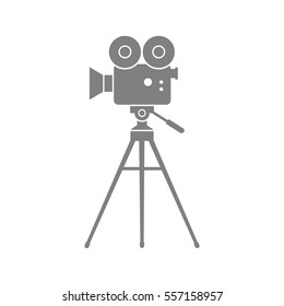 Grey movie camera on white background