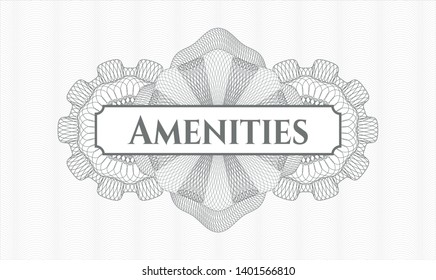 Grey passport money rosette with text Amenities inside