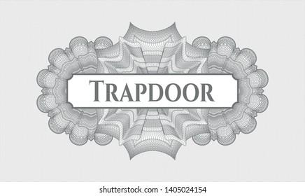 Grey passport money rosette with text Trapdoor inside