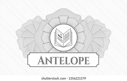 Grey rosette or money style emblem with book icon and Antelope text inside