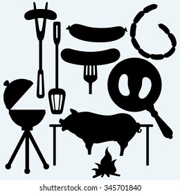 Grilled sausage on fork and on frying pan, set of bbq objects, and roasted pig. Isolated on blue background. Vector silhouettes