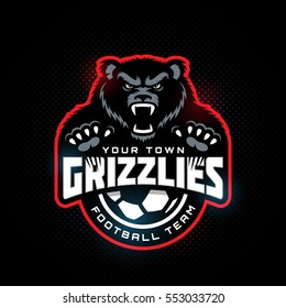 Grizzly bear mascot for a soccer team on a dark background. Vector illustration.