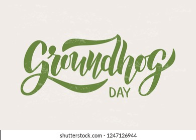 Groundhog Day typography poster. Hand drawn brush lettering on beige background. For poster, badge, invitation, card, flyer, advertising, web. Vector illustration.