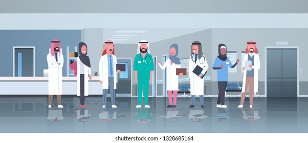 group of arabic doctors team treatment communication concept arab medical hospital mix race workers standing together modern clinic hall interior full length horizontal