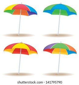 A group of beach umbrellas in multiple colors isolated on white.