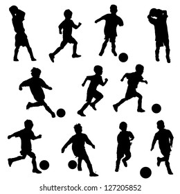 A group of boys in silhouettes playing soccer or football