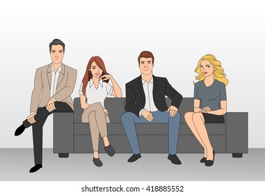 Group of business people seated on a sofa