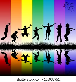 Group of children jumping over a rainbow striped background