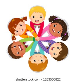 Group of children putting hands together on white background