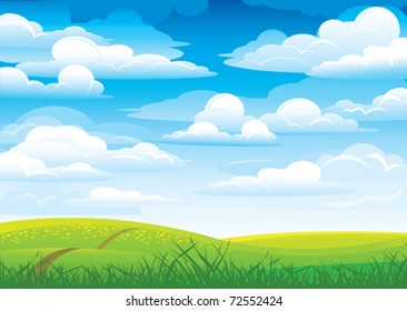 Group clouds on blue sky and green meadow with road and flowers