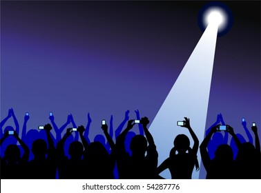 Group of excited youngsters attending some illuminated show, applauding and taking videos with their cameras and cell phones