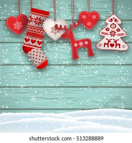 Group of hanging christmas decorations in scandinavian style in front of blue wooden wall, includes hearts, deer, tree and santa's stocking, vector illustration, eps 10 with transparency and gradient