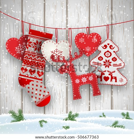 group of hanging christmas decorations in scandinavian style in front of white wooden wall includes