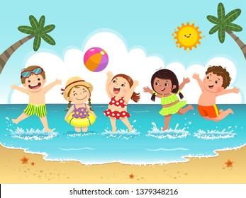 Group of happy kids having fun and splashing on the beach.