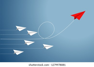 Group of Paper plane are competition to destination and one red paper plane pointing in different way go to success goal