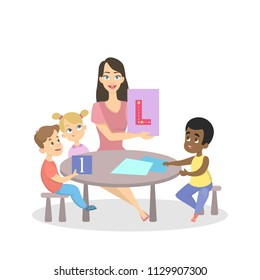 Group of preschool boys and girls sitting at the desk and studying alphabet with female teacher. Isolated vector illustration in cartoon style