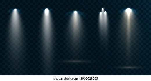 Group of spotlights isolated on transparent background. Light effect with rays and highlights. Vector 10 eps.