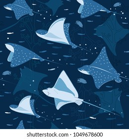 Group of various rays gracefully gliding through the blue ocean