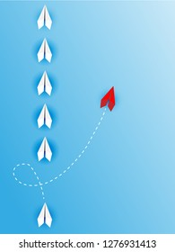 Group of white paper plane in one direction and one red paper plane pointing in different way on blue background. Business concept for new ideas, creativity, innovation and solution