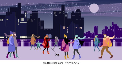 A group of young urban warmly dressed  people walk in the evening winter city quay