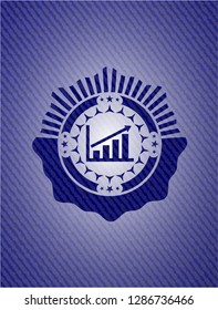 growth chart icon inside jean or denim emblem or badge background