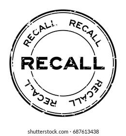 Grunge black recall round rubber seal stamp on white background
