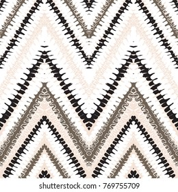 Grunge chevron vector pattern with abstract lines and stripes. Bold zigzag print with ethnic, tribal and retro motif in vintage bohemian chic style. Modern hand drawn doodle texture in light colors