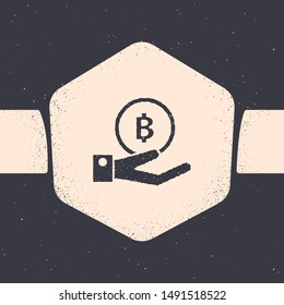 Grunge Hand holding Bitcoin icon isolated on grey background. Blockchain technology, digital money market, cryptocoin wallet. Monochrome vintage drawing. Vector Illustration