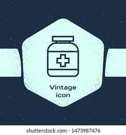 Grunge line Medicine bottle icon isolated on blue background. Bottle pill sign. Pharmacy design. Monochrome vintage drawing. Vector Illustration