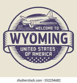 Grunge rubber stamp or tag with airplane and text Welcome to Wyoming, United States of America, vector illustration