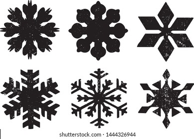 Grunge Snowflakes Stamps Collection. Can be used as Banners, Insignias or Badges. Vector Distressed Textures Set. Blank Geometric Shapes. Vector Illustration. Isolated on white background. EPS10.