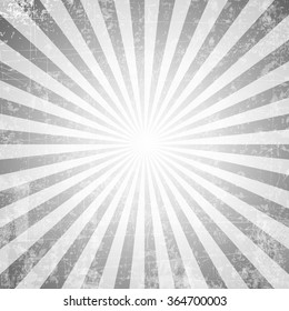 Grunge style abstract starburst & sunburst background with faded and desaturated soft tones