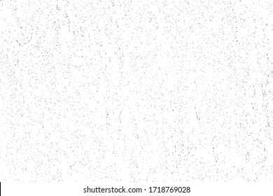 Grunge surface texture with small, randomly scattered dots. Abstract monochrome background with grain, sand and mud. Vector illustration. Overlay template.