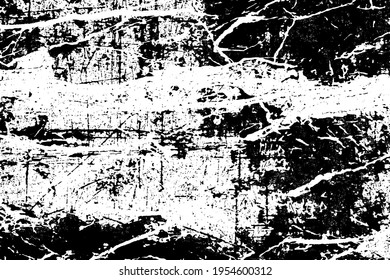 The grunge texture is black and white. Monochrome abstract background. Pattern of scratches, chips, and paint strokes. Black smudges, scuffing, wear and tear