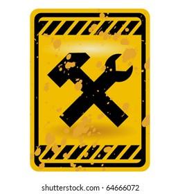 Grunge under construction warning sign isolated over white
