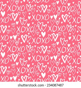 Grunge vector seamless pattern with hand painted hearts and words xoxo. Bright pink bold print for valentines day decor or wedding invitation card background